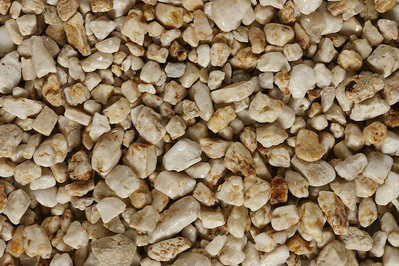 Rock versus mulch get to know their differences for Landscaping rocks quartz