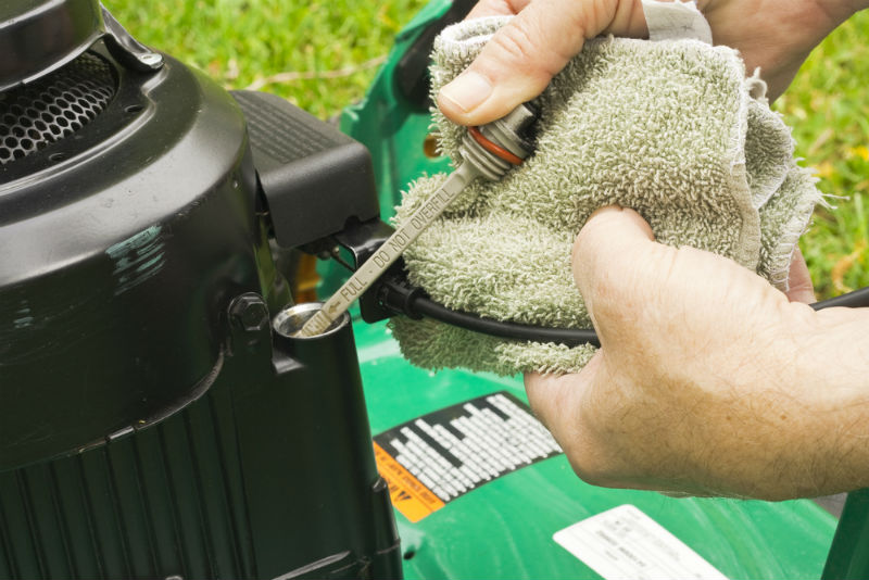 Maintain proper oil level in lawn mower
