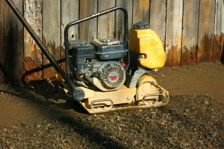 compactor to help pack the dirt down